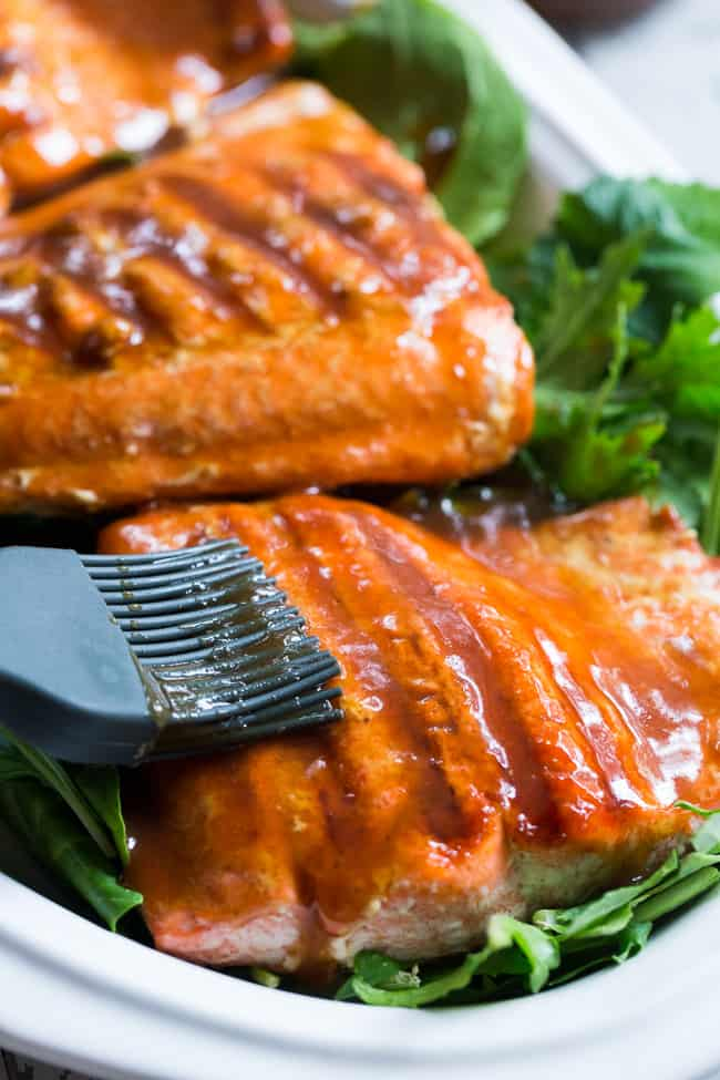 This Paleo and Whole30 Grilled Teriyaki Salmon is incredibly easy and busting out with flavor!  A simple date-sweetened teriyaki sauce is drizzled all over perfectly grilled salmon fillets and topped with toasted sesame seeds and scallions.  Perfect over a green salad or cauliflower rice!