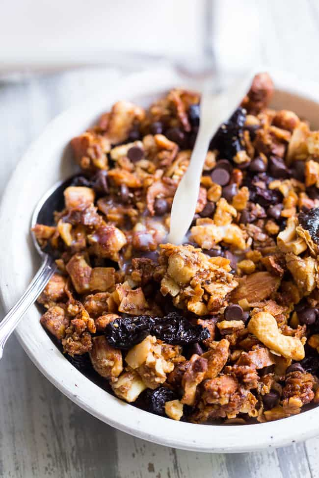 This crunchy paleo granola is loaded with goodies and so incredibly tasty!   Grain free granola clusters are baked with maple and tossed with sweet and tart dried cherries and dark chocolate chips.  It makes the perfect sweet snack or breakfast that everyone will love!  Gluten free, vegan, paleo.