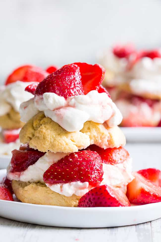 Classic strawberry shortcake is made gluten-free, dairy-free, and paleo yet it's every bit as delicious as the original!  Grain free Paleo biscuits are filled with lightly sweetened strawberries and an easy coconut whipped cream for a fun anytime dessert that everyone will love.
