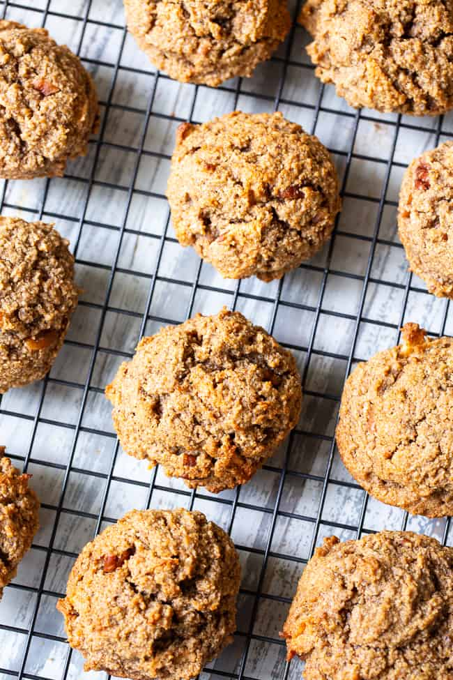 These soft and chewy cinnamon apple pecan cookies have it all! Gluten-free, paleo, and vegan cookies packed with warm spices, chewy dried apples and chopped pecans in every bite! They're kid approved, fun to make and make an incredibly tasty fall dessert!
