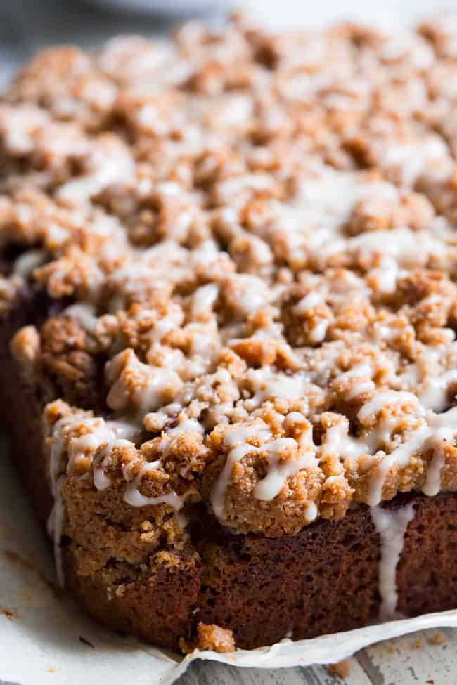 This paleo cinnamon apple coffee cake has it all! Perfectly moist grain free dairy free coffee cake topped with a layer of homemade apple pie filling and a crumble top. It's one of my favorites for fall baking and I know you and your family will love it as well!