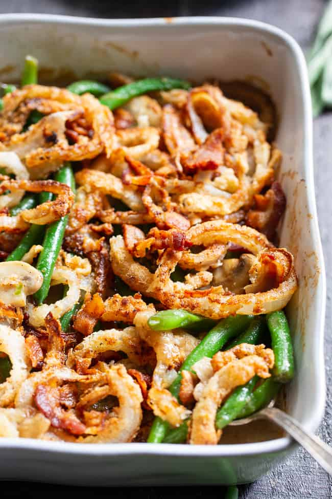 This paleo green bean casserole is savory, creamy, and topped with both bacon and crispy fried onions!  It's a healthier version of the classic casserole that's gluten-free, dairy-free, Whole30 compliant and family approved!  It's perfect for your holiday table or a cozy cold weather dinner. paleo Thanksgiving. Whole30 Thanksgiving.