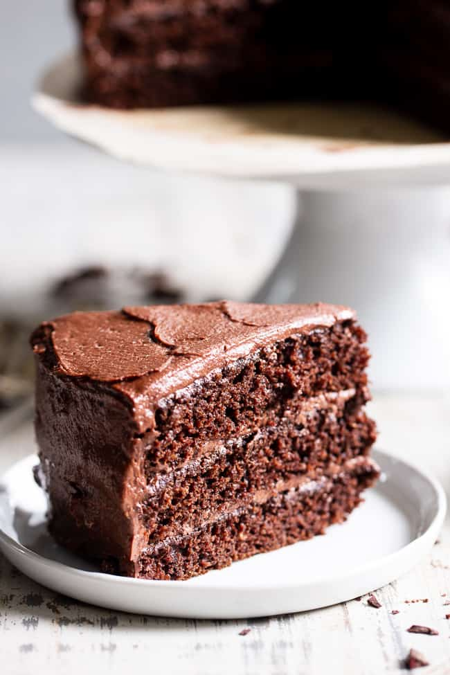 "This rich, decadent, moist and tender paleo chocolate cake is made healthier with a blend of grain free flours, organic coconut oil and unrefined coconut sugar.  The dairy-free ""buttercream"" frosting is out of this world delicious and NONE of it tastes paleo, even though it totally is!  Paleo dessert. Paleo cake. Paleo birthday. Paleo baking. Paleo treats. Paleo chocolate."