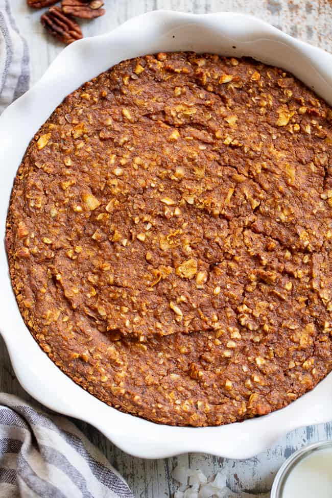 """This pumpkin """"oatmeal"""" bake is totally grain free yet tastes just like classic baked oatmeal. It's packed with pumpkin and pumpkin pie spices, and pure maple syrup adds just the right amount of sweetness. It reheats perfectly, making it a great fall comfort food breakfast when you're on the go! Paleo, dairy-free, egg free, and vegan."""