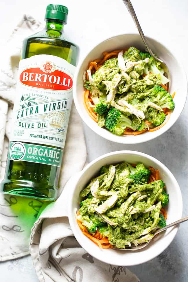 [This paleo and Whole30 pesto chicken with broccoli and sweet potato noodles is packed with flavor and super simple to prepare.  It's perfect for weeknight dinners and date nights alike!  An easy and fun paleo dinner!] #Bertolli #TheRecipeIsSimple #evoo #QualityOliveOil and #ad