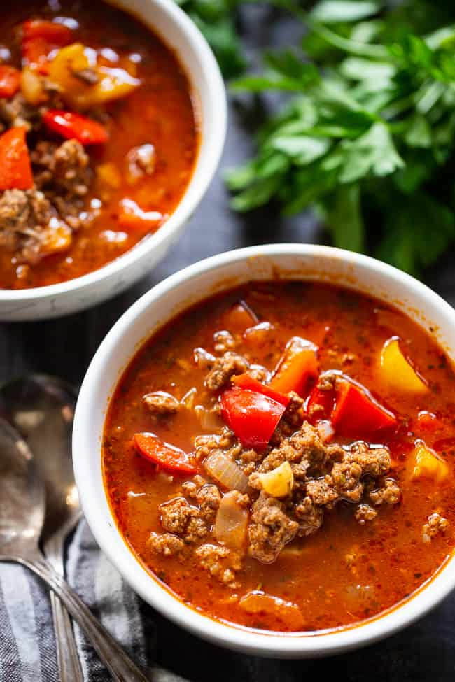 """This stuffed pepper soup is loaded with everything you're craving! Italian spices, savory ground beef, garlic and onions, bell peppers, and cauliflower """"rice"""" make this a hearty soup that's also super healthy for you. Gluten-free, dairy-free, keto and Whole30 friendly."""