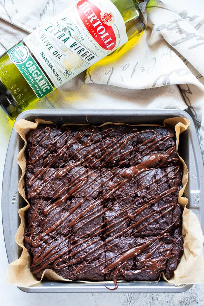 These triple chocolate olive oil brownies are made with no flour, refined sugar or butter and have a deep, rich flavor and texture thanks to Bertolli Organic Extra Virgin Olive Oil and quality chocolate. They're grain free, dairy-free, and paleo.  #Bertolli #TheRecipeIsSimple #evoo #QualityOliveOil #ad