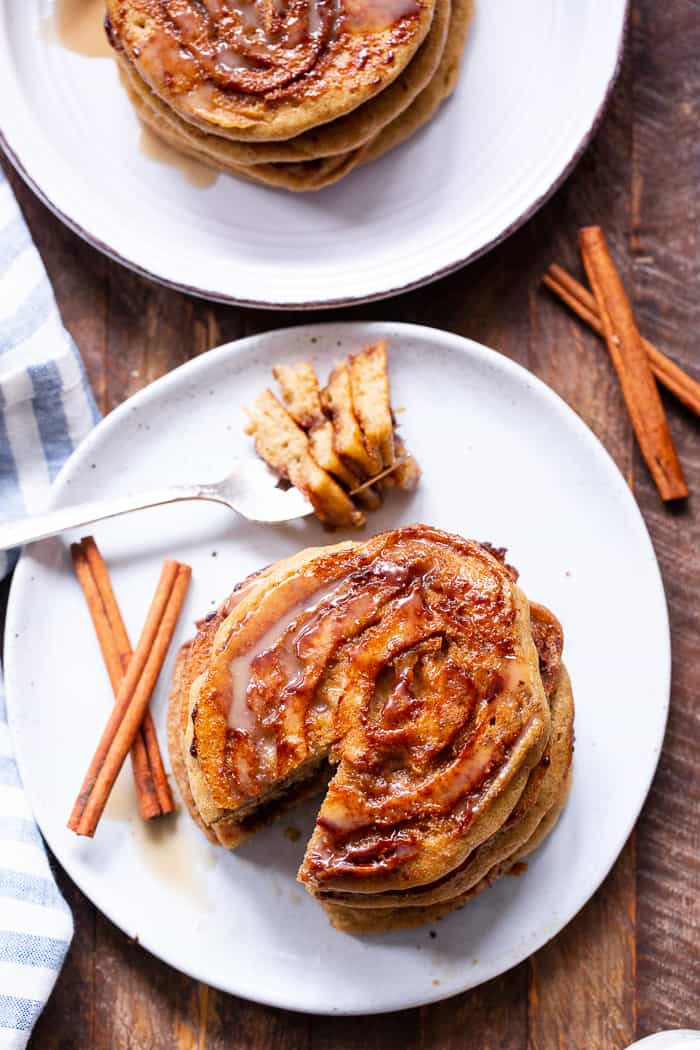 These grain free and paleo cinnamon roll pancakes have a gooey cinnamon swirl and maple glaze for the best of all things cinnamon roll without the work!   Family approved, gluten-free, with a dairy-free option. Paleo breakfast.  Gluten-free pancakes.  Paleo pancakes.  Paleo Christmas recipes.  Paleo Christmas.