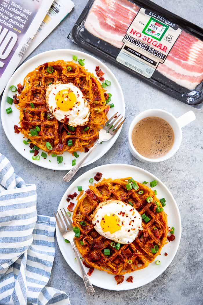 These savory bacon and sweet potato waffles are crisp on the outside, packed with tons of flavor and a fun weekend breakfast or brunch!  Top them with fried eggs and more crispy bacon for a super tasty, filling, wholesome meal that you'll want to make again and again!  Paleo and Whole30 friendly. #AD @JonesDairyFarm #JonesDairyFarm