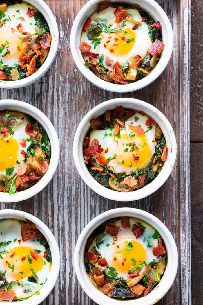 Made in single serving ramekins, these baked eggs are packed with savory goodies and flavor!   Great for weekend brunches and make-ahead friendly for weekdays.  Paleo, Whole30 compliant and keto friendly.