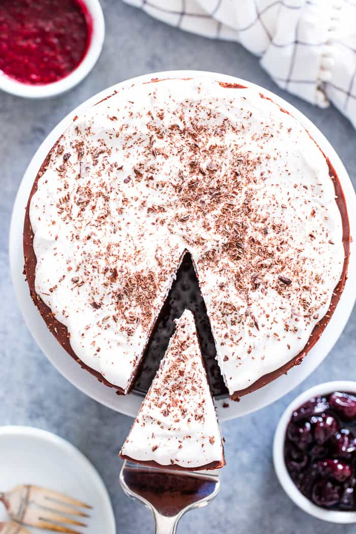 Get excited, because the creamiest, smoothest, richest vegan chocolate cheesecake is about to happen in your kitchen!  This cheesecake has a chocolate cookie crust with a cashew and coconut cream based chocolate filling that tastes like a traditional cheesecake.  It's paleo, gluten-free, vegan, and refined sugar free.