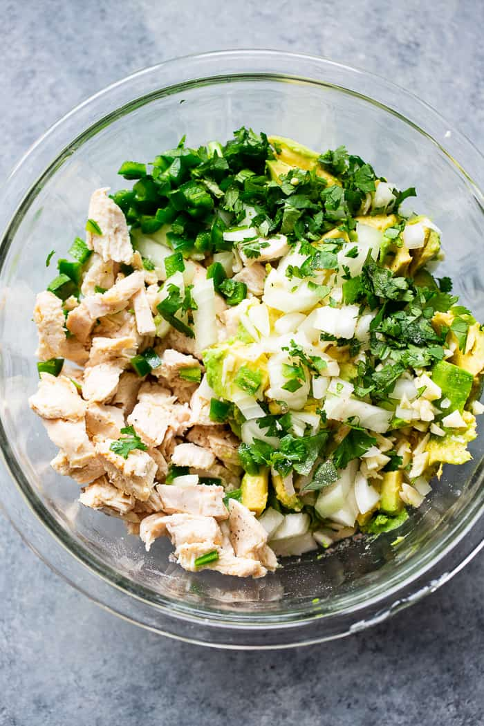 Since guacamole and chicken salad are two of our favorite things, I decided it was time to combine them!  This guacamole chicken salad is mayo-free, packed with flavor, protein, and perfect for easy lunches!  It's paleo, Whole30 compliant and keto friendly, too.