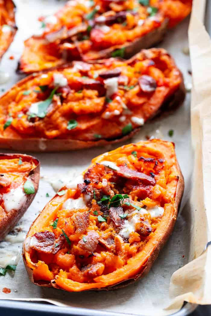 We're taking sweet potatoes to a new level today with these spicy loaded buffalo sweet potato skins!  The skins are baked until crisp and then loaded with the most delicious filling.  One bite and you'll be addicted!  Perfect appetizer or fun side dish that just happens to be Whole30 compliant.
