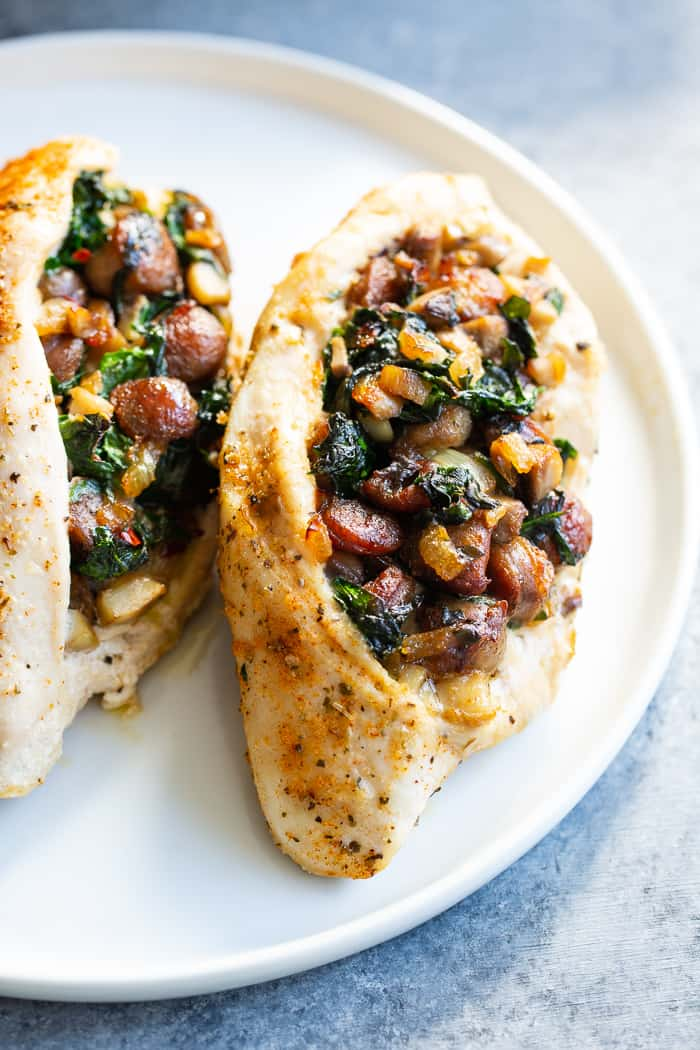 Pinterest: This stuffed chicken is loaded with all your favorite things!  Savory sausage, mushroom, and spinach stuffing baked in seasoned chicken breasts makes this a protein packed, filling meal that's Paleo, Whole30 and keto friendly!  #AD #JonesDairyFarm