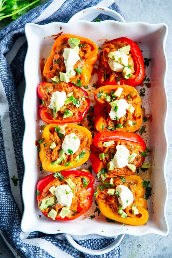 These chicken enchilada stuffed peppers have a creamy, savory, flavor-packed filling that you won't believe is dairy-free, paleo, and Whole30 compliant!  These stuffed peppers are easy to throw together and perfect to make ahead of time for weeknights.