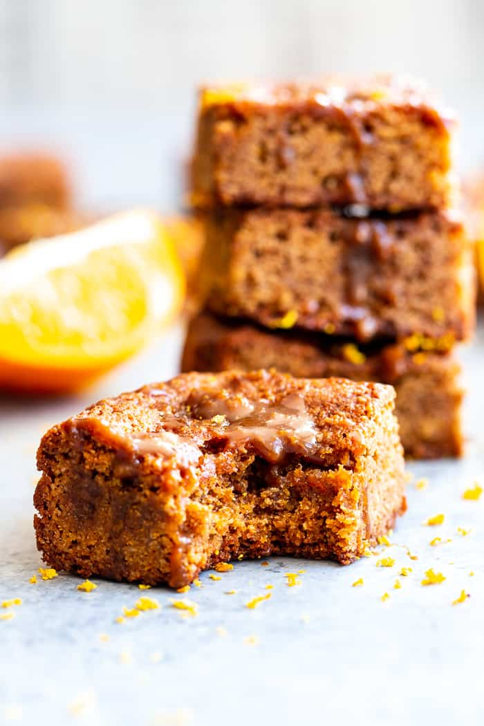 These gooey orange caramel blondies are the perfect blend of sweet caramel and citrus!  Chewy orange blondies are swirled with orange infused dairy-free caramel for a fun twist on a favorite dessert. They're gluten-free, paleo, dairy-free, and refined sugar free.