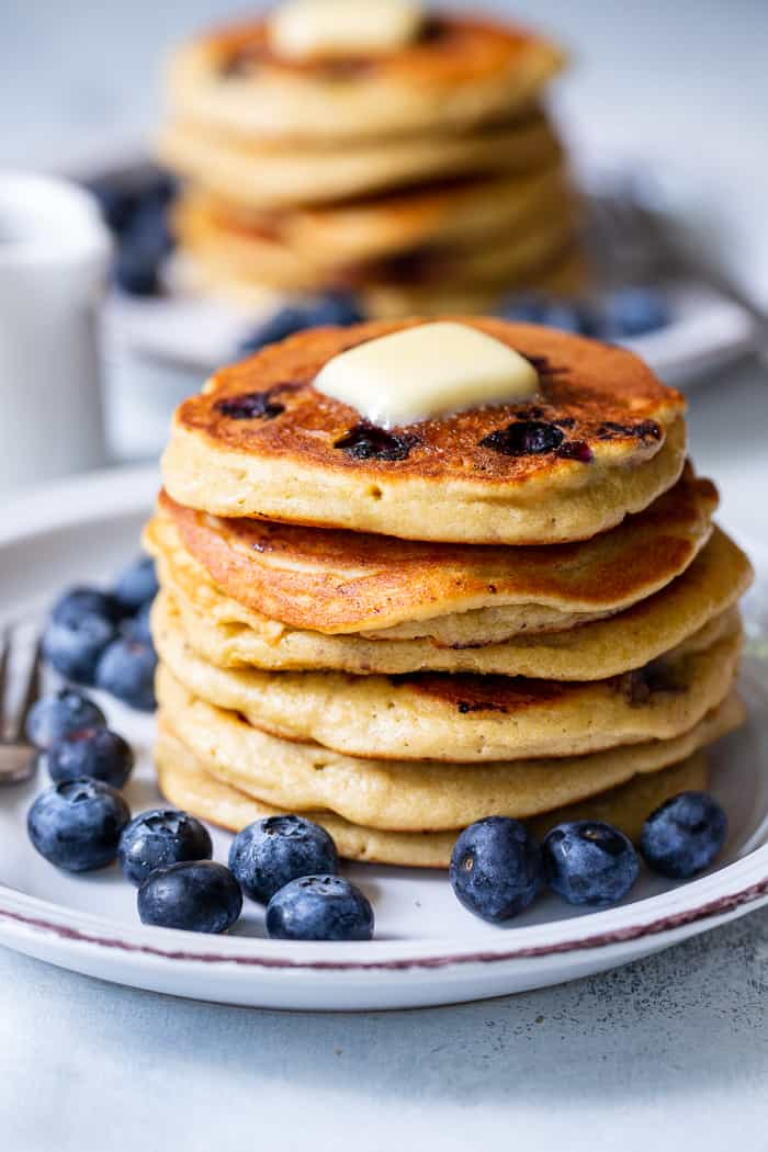 These fluffy paleo buttermilk blueberry pancakes are the perfect healthy answer to your pancake cravings! They come together quickly and are a hit with kids and adults alike. Grain free, nut free, dairy free and freezable, which makes them great for breakfast or brunch anytime!