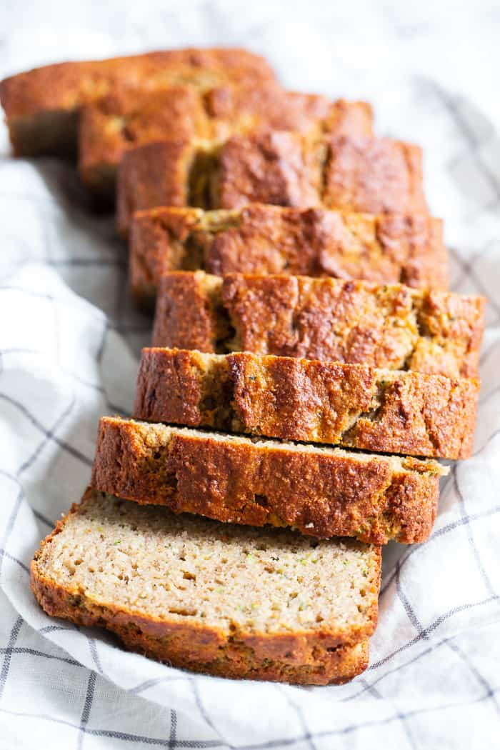 This gluten free and paleo zucchini banana bread is soft and tender, moist, cake-like and has just the right amount of sweetness.  Perfect for breakfast toasted and slathered with almond butter or for an afternoon snack.  Experiment with adding your favorite mix-ins to this simple grain free, dairy free quick bread!