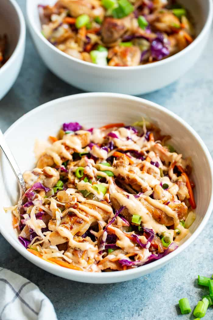 Simple yet incredibly delicious, these Paleo Egg Roll Bowls with Chicken are bound to become a new go-to for you! An easy stir fry that tastes just like an egg roll topped with a sesame aioli that you'll want to put on everything! Whole30 and keto friendly too.