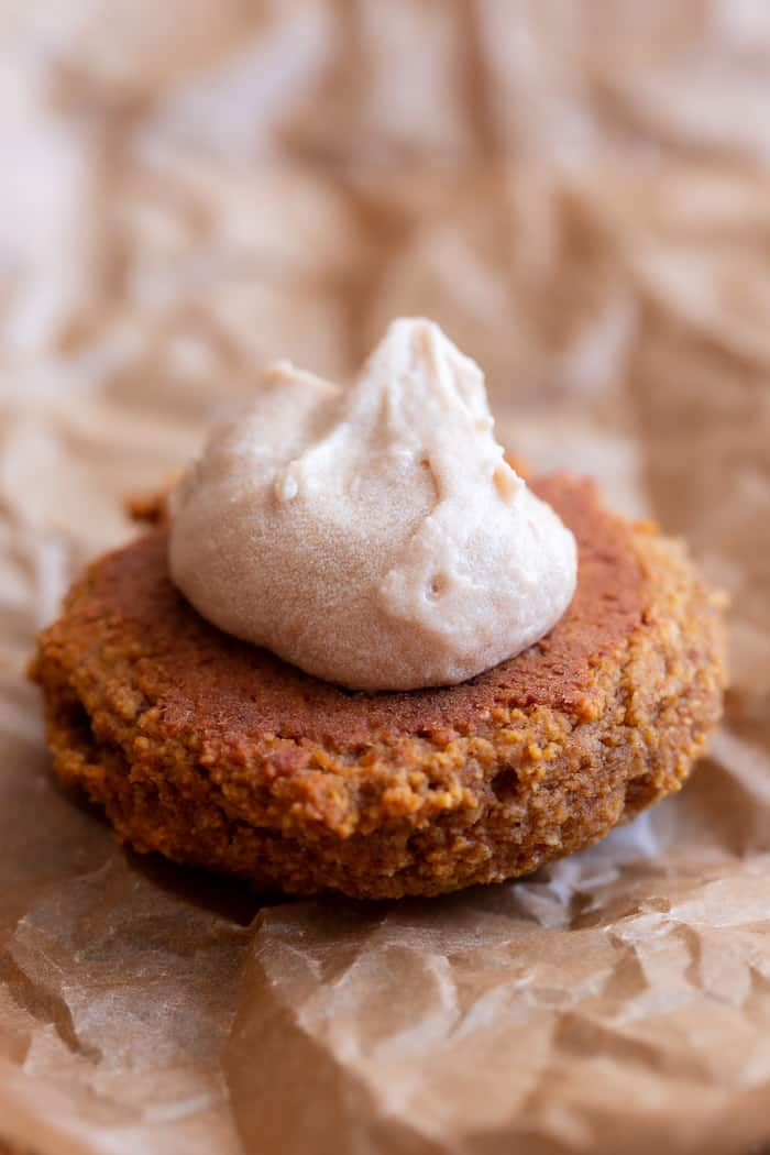 These soft pumpkin cookies are sweet and packed with warm spices and a sweet maple cream filling.  You can make them as sandwich cookies or simply spread them with the icing - it's pumpkin spice heaven either way!  They're gluten free, dairy-free, refined-sugar free and paleo.