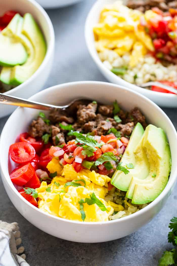 These loaded breakfast taco bowls are a fun breakfast idea and great for dinner too!  They're easy to prep ahead of time, just make sure you leave out the avocado until you're ready to serve.  Gluten-free, Paleo, Whole30 compliant, and keto diet friendly.