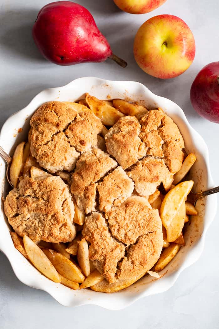This paleo and vegan pear apple cobbler is a dreamy fall dessert made healthier with no refined sugar, grains, or dairy.  A gooey apple pear filling is topped with sweet crisp cobbler and baked to golden brown perfection!  Serve with your favorite dairy free ice cream for the ultimate treat!