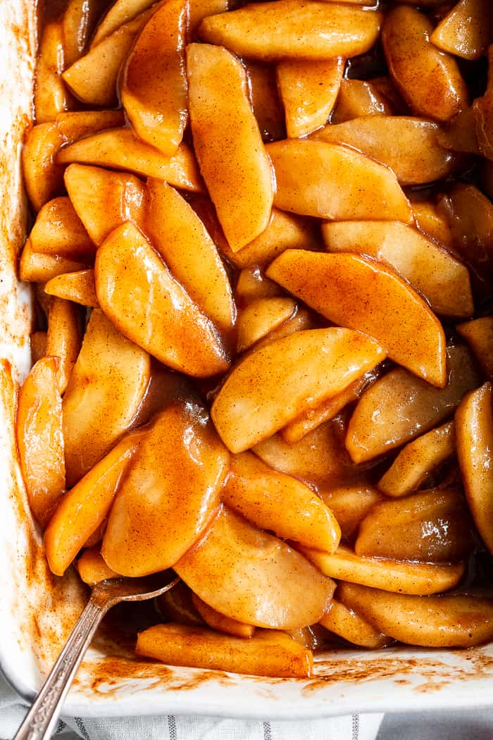 These gooey caramel cinnamon baked apples taste better than apple pie filling with almost no effort at all!  These baked apples are refined sugar free, paleo, vegan, and perfect with a big scoop of coconut vanilla ice cream!