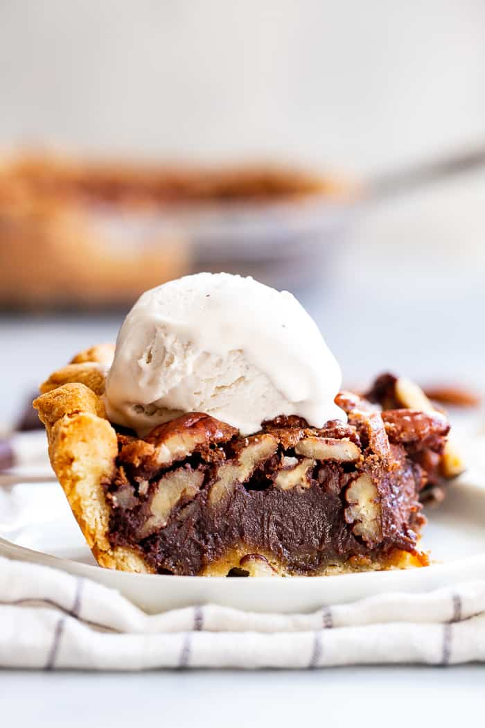 This deliciously rich and gooey chocolate pecan pie is everything you're craving in a holiday dessert!   Perfect with a big scoop of coconut vanilla ice cream on top, this family favorite is gluten-free, paleo, and dairy-free but no one will know.