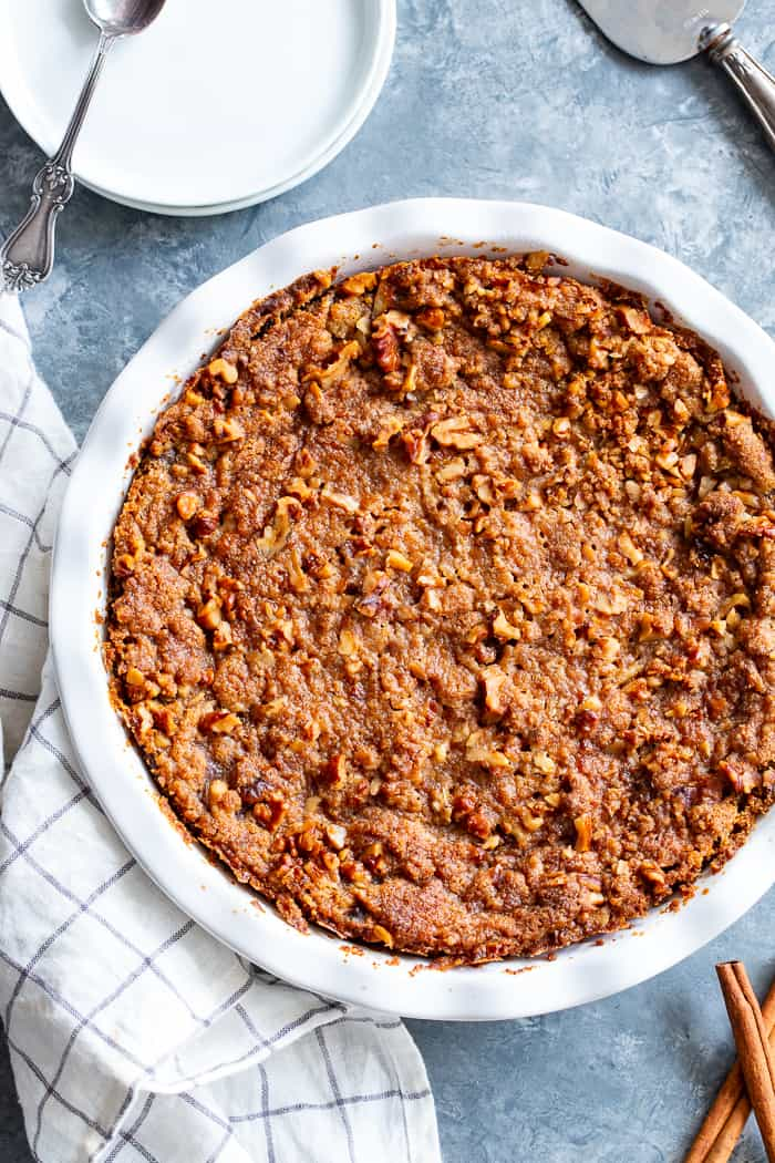 This Pumpkin Crumble has all the delicious flavors of pumpkin pie but it's so much easier to make! A creamy pumpkin layer is topped with a crunchy toasty grain free crumble and baked until golden brown. Perfect for any holiday table and delicious with a dollop of whipped cream! Paleo, gluten-free.