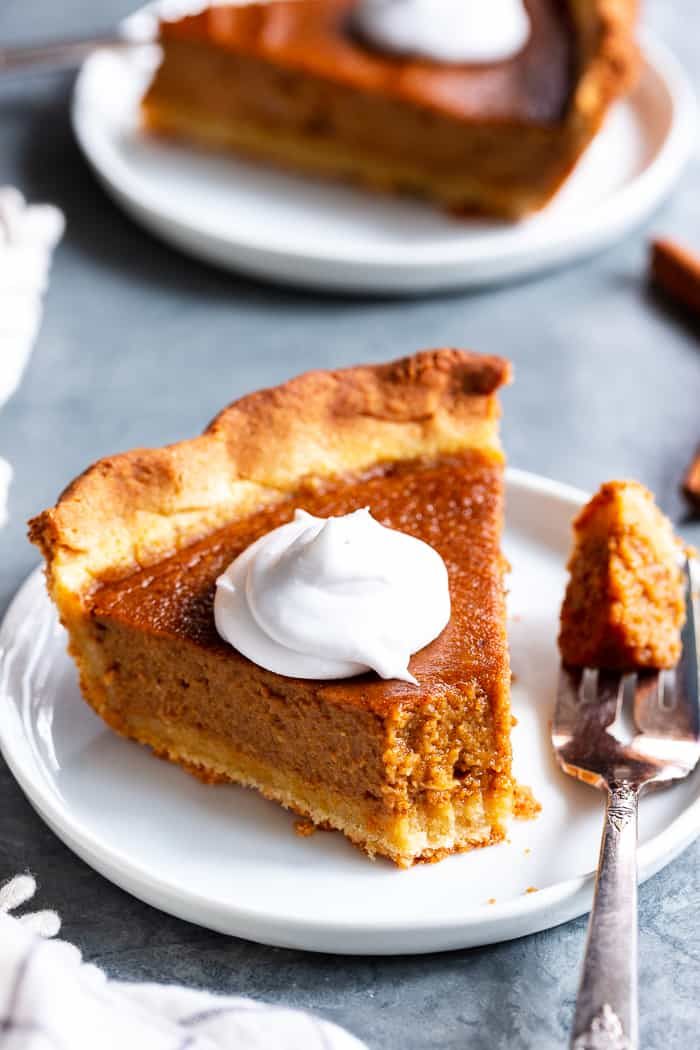 This Paleo Sweet Potato Pie will be a showstopper on your holiday table!  With a grain free and paleo crust that tastes just like the real deal, and a creamy filling filled with sweet warm spices, you'll be hooked with the first bite.  It's gluten-free, grain free, refined sugar free, and has a dairy free option.