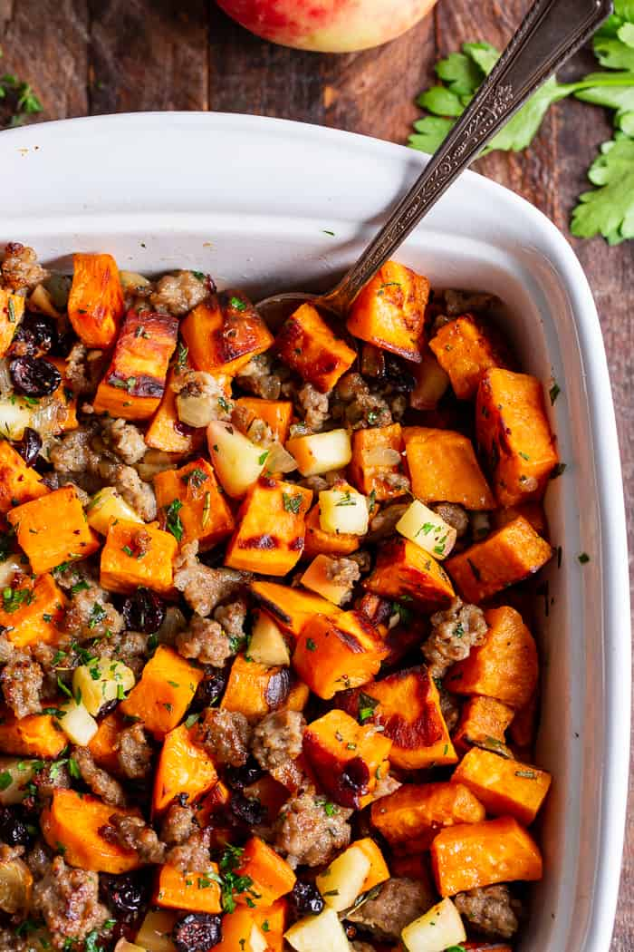 This delicious Paleo Sweet Potato Stuffing with Jones Dairy Farm No Sugar All Natural Pork Sausage Roll, apples and cranberries has all the flavor of traditional Thanksgiving stuffing but is grain free, gluten free, dairy free and Whole30 compliant too! Toasty, roasted sweet potatoes and savory, all natural sausage form the base of this favorite holiday side dish. It's sweet savory perfection! #AD #Jonesdairyfarm