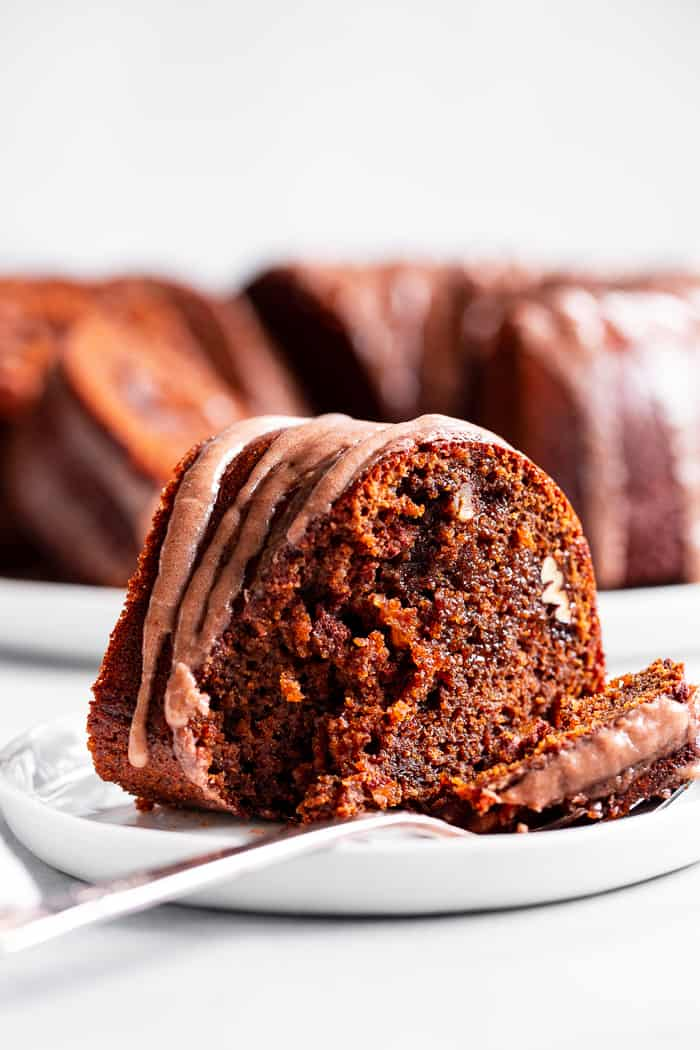 This grain free and paleo Gingerbread Bundt Cake is moist and tender, with a sweet cinnamon maple pecan swirl!  Topped with a sweet maple glaze, this gluten-free, dairy-free cake is sure to be a favorite for the holiday season!