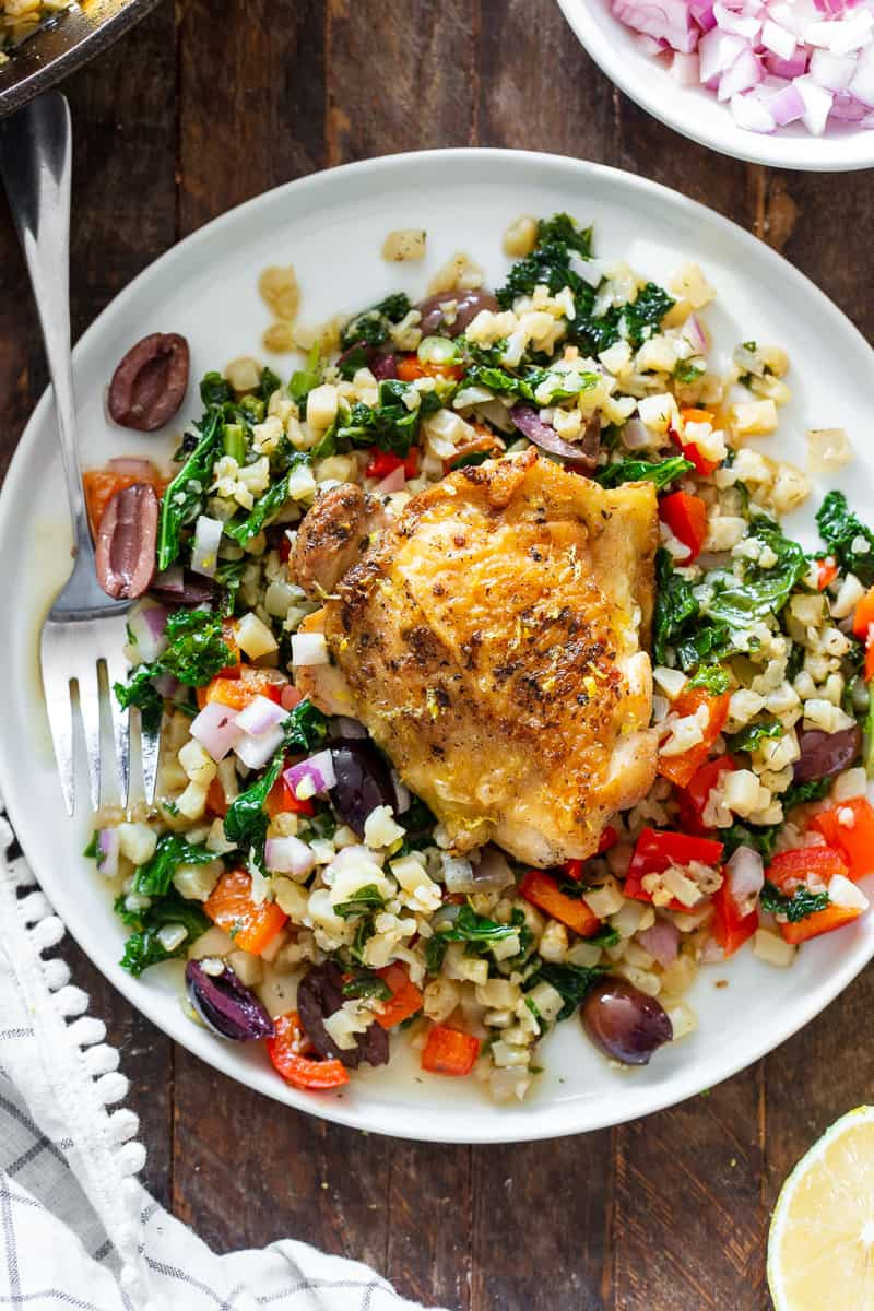 This Greek Chicken and veggies is packed with flavor, made all in one skillet and perfect for weeknights. It's a simple Paleo and Whole30 dinner that you'll want on repeat in your house!