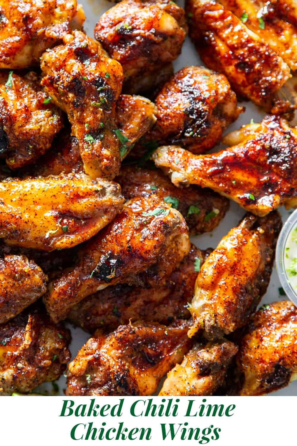 These sweet and spicy chili lime chicken wings are packed with flavor and perfect for parties, appetizers or a fun dinner!  These crispy baked chicken wings are paleo with a Whole30 option to sweeten the sauce, family friendly and a total crowd pleaser. #Paleo #cleaneating #wings #whole30 #superbowl