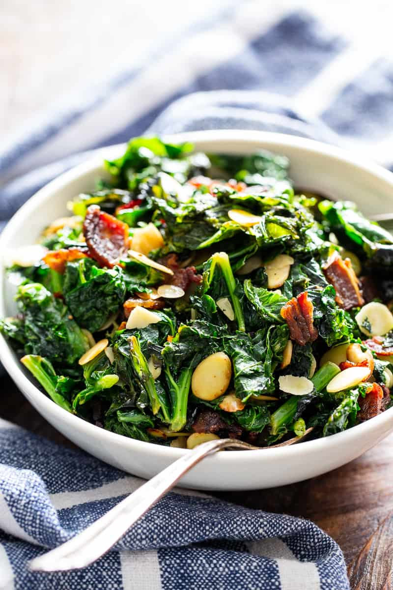 This delicious and simple sautéed kale with bacon and almonds is a savory healthy side dish that you'll want on repeat!  It's paleo and Whole30 friendly, keto, and Low FODMAP.  Serve it with any main course to add lots of flavor and nutrients to your meal.