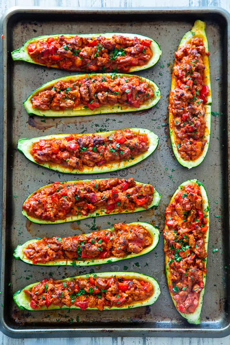 These hearty Italian Zucchini Boats are flavor packed and make a quick, healthy and fun dinner!   They're also perfect to meal prep ahead of time for busy nights and are totally dairy-free, grain free, keto, paleo and Whole30 compliant, and Low FODMAP. #cleaneating #lowFODMAP #keto #paleo