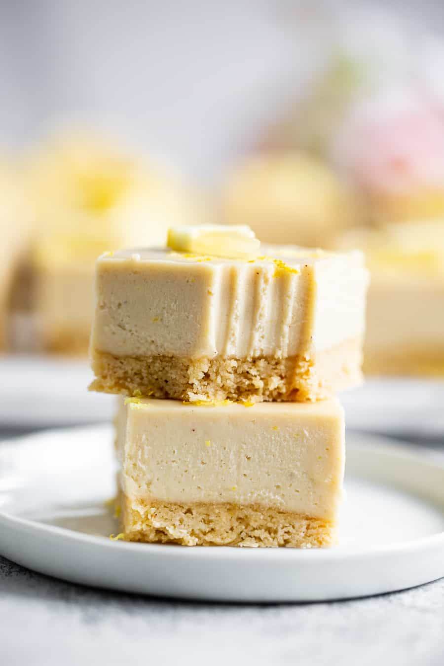 These tart, sweet, paleo lemon bars have a sugar cookie crust and creamy cashew based lemon layer. This healthy spring dessert is totally dairy free, paleo, egg free with a vegan option. Great easy dessert for holidays like Mother's Day and Easter. I used affordable paleo baking ingredients from ALDI to make all the flavors shine. #paleo #cleaneating #vegan #AD