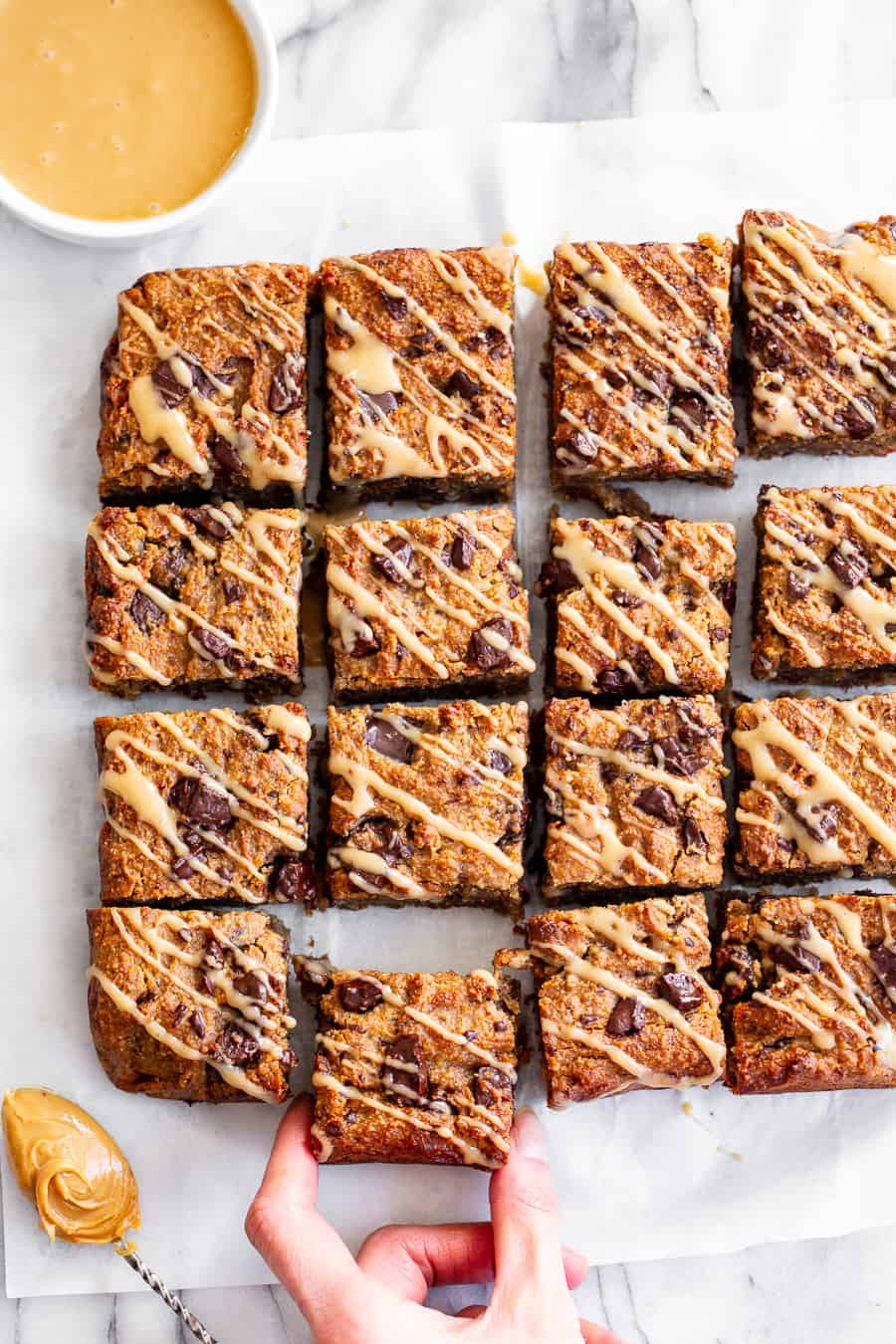 These one-bowl almond butter banana bread bars are a simple and totally delicious treat to make any time! Great for snacks and dessert, they're packed with good fats, banana flavor and dark chocolate. Top them with an almond butter icing to take them to the next level! Vegan, paleo, refined sugar free, egg free. #vegan #paleo #glutenfree