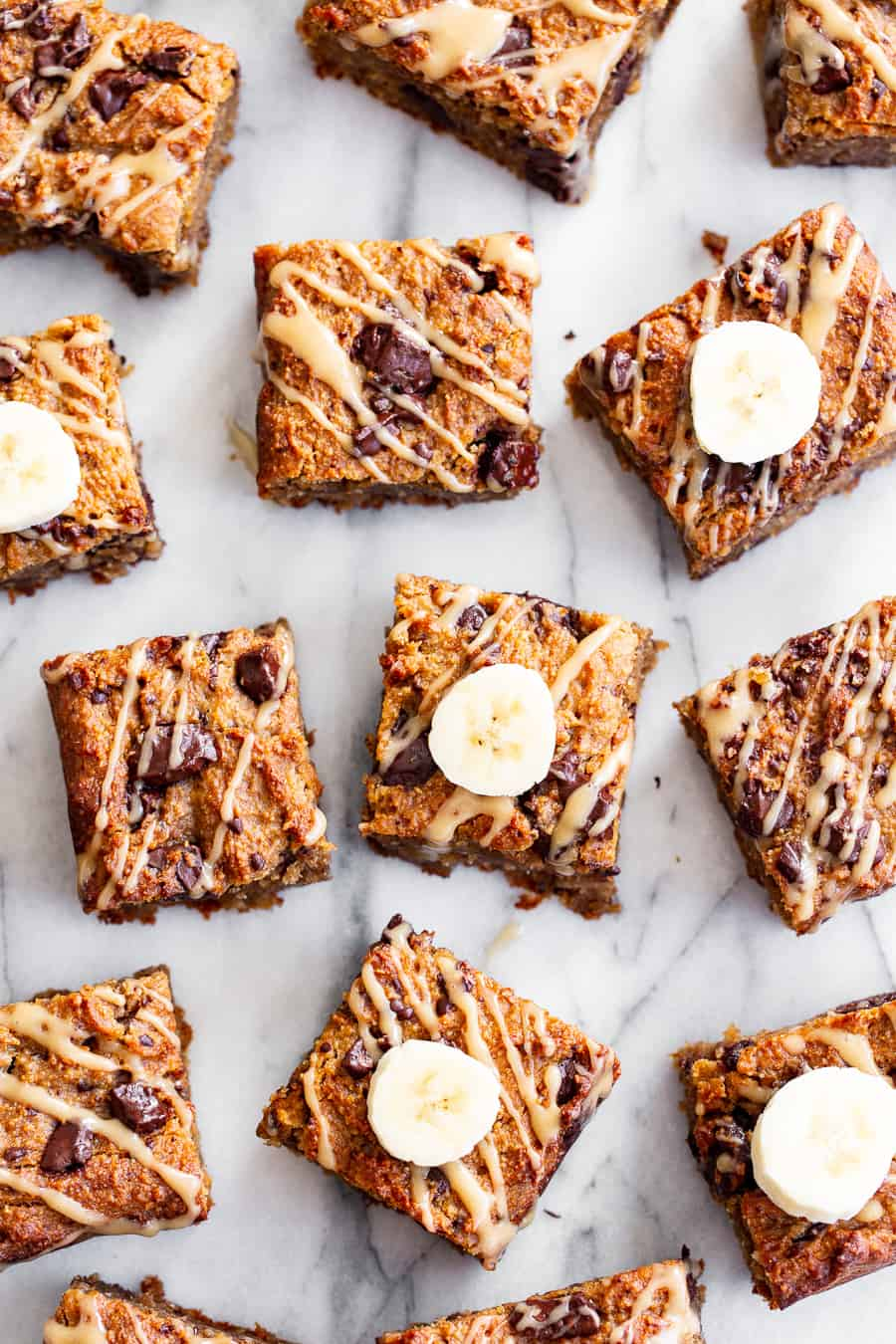 These one-bowl almond butter banana bread bars are a simple and totally delicious treat to make any time! Great for snacks and dessert, they're packed with good fats, banana flavor and dark chocolate. Top them with an almond butter icing to take them to the next level! Vegan, paleo, refined sugar free, egg free. #paleo #vegan #glutenfree