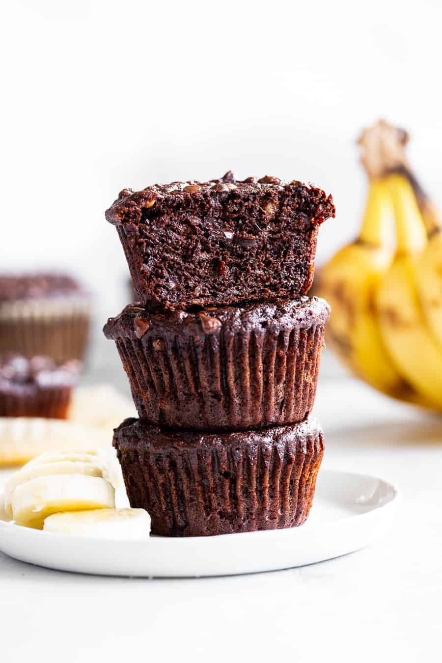 These moist and tender double chocolate banana muffins are quick and easy to make and taste just as decadent as rich chocolate cupcakes! Made with coconut flour and raw cacao powder so they're paleo plus nut free, gluten free, and dairy free. Kid approved and great for snacks and dessert! #paleorecipes #bananamuffins #paleo #paleobaking #glutenfree #coconutflour