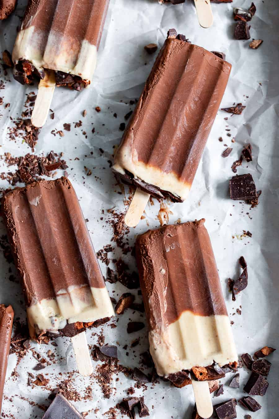 These chocolate peanut butter fudgesicles are just what you need for a healthy frozen treat!  Packed with rich chocolate flavor and a fudgy texture, they're dairy free, refined sugar free, vegan and paleo.  Easy to make in a blender and family approved! #vegan #paleo #peanutbutter #fudgesicles #popsicles #dairyfree #cleaneating