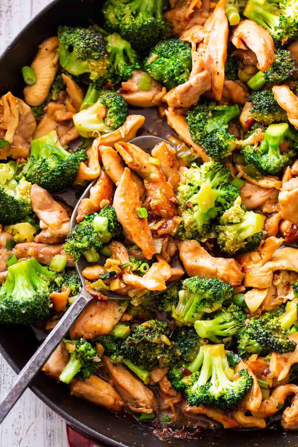 This quick and tasty paleo chicken and broccoli stir fry uses clean simple ingredients and is so much healthier than takeout but just as fast! It's family approved and great for weeknight dinners. I love serving it over fried cauliflower rice to keep it paleo, Whole30 compliant and low carb too. #paleo #whole30 #cleaneating #keto
