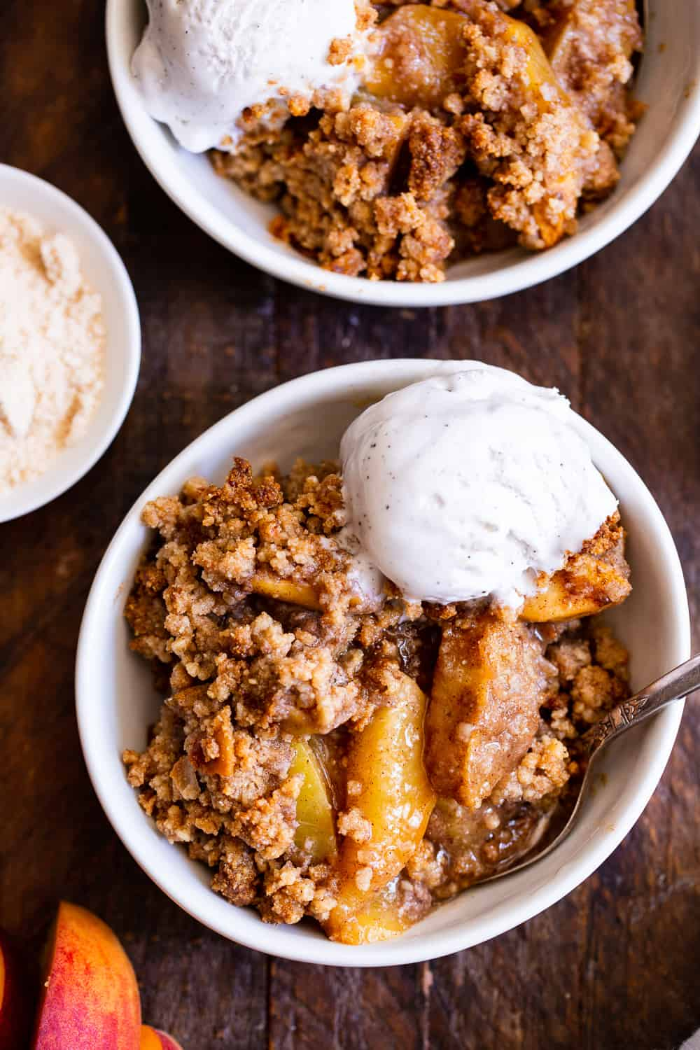 This paleo peach crisp has a juicy sweet peach filling with a toasty crisp topping that's out of this world delicious! It's truly the best peach crisp you'll ever make. A fast family favorite for peach season, this crisp is paleo, vegan and gluten free. #paleo #dessert #peaches #vegan #cleaneating #glutenfreebaking