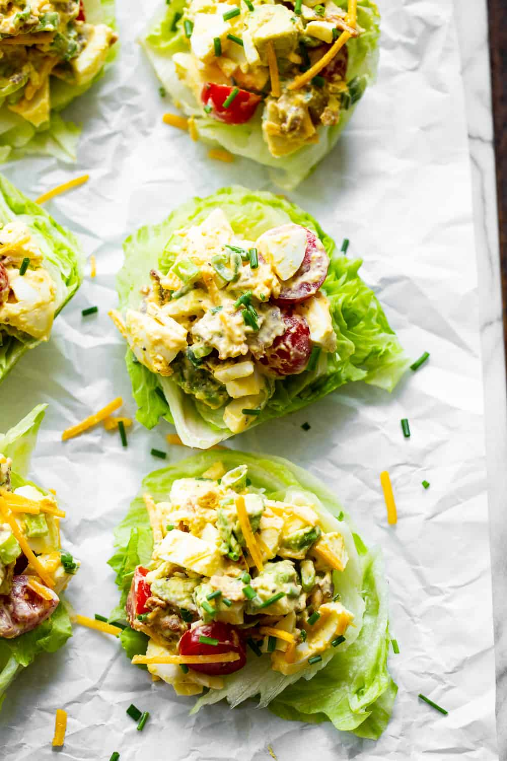 This cobb egg salad has all the goodies you'll find in your favorite cobb salad! Perfect for summer lunches and picnics, serve it over a simple green salad or in lettuce wraps for a protein packed meal with tons of flavor! Paleo, Whole30, low carb and keto friendly. #paleo #keto #whole30 #cleaneating