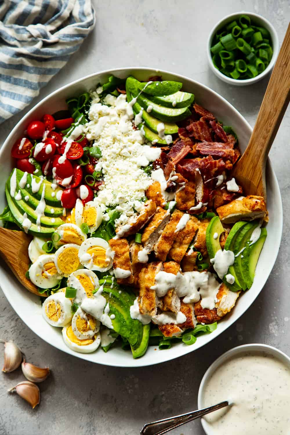 """This crispy chicken cobb salad is my favorite one yet with flavorful crispy """"breaded"""" chicken plus all the usual cobb salad goodies and a homemade garlic ranch dressing. It's paleo, with a Whole30 option, low in carbs and family approved! #paleo #whole30 #cleaneating #keto #lowcarb"""