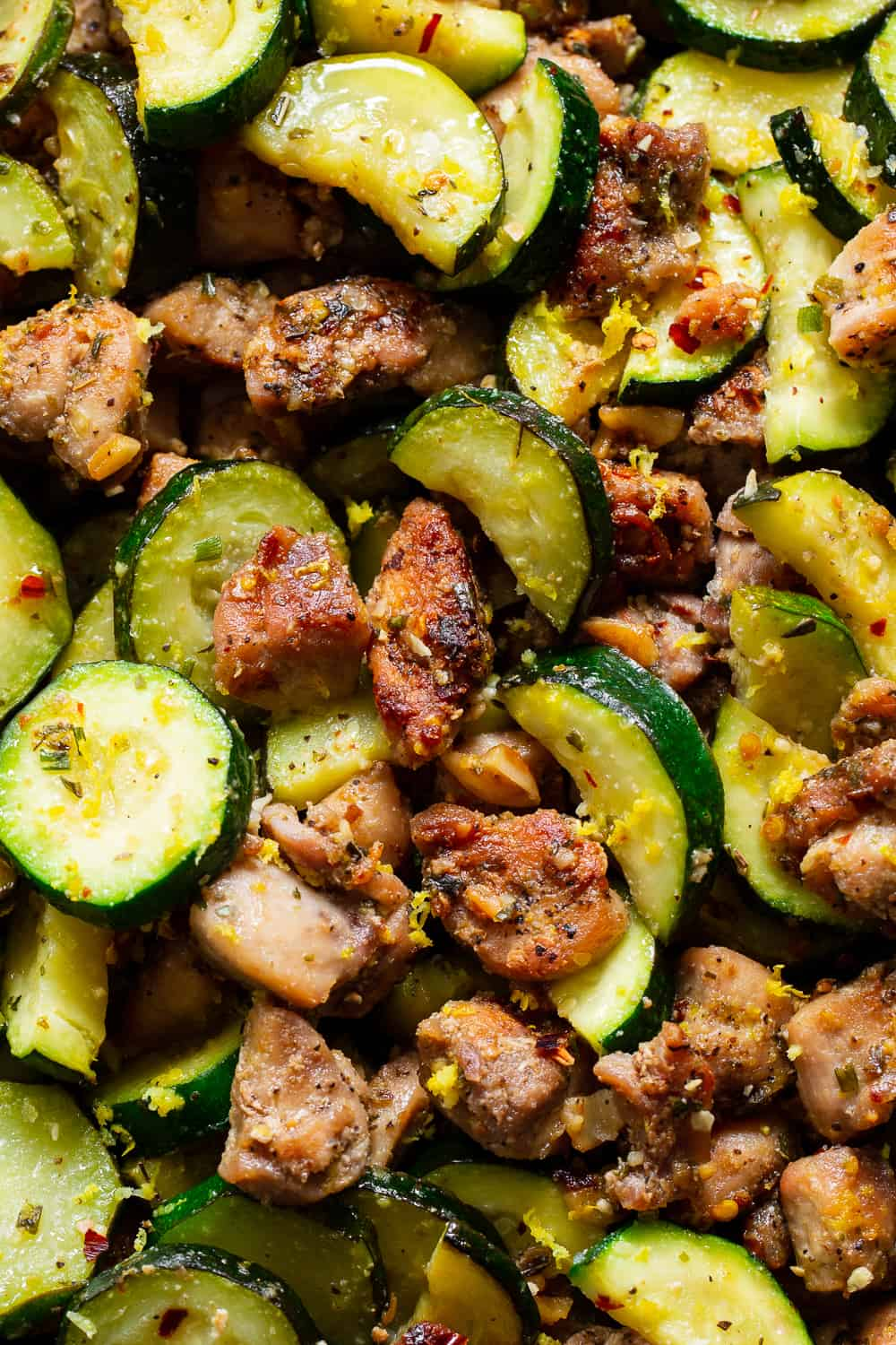 This Lemon Garlic Chicken Zucchini is packed with flavor, fast and easy for weeknights! Bite sized chicken thighs are perfectly seasoned and sautéed with zucchini and garlic then tossed with lemon juice and zest. Great alone or served over grain free noodles or cauliflower rice to keep it paleo, keto and Whole30. #paleo #whole30 #keto #cleaneating