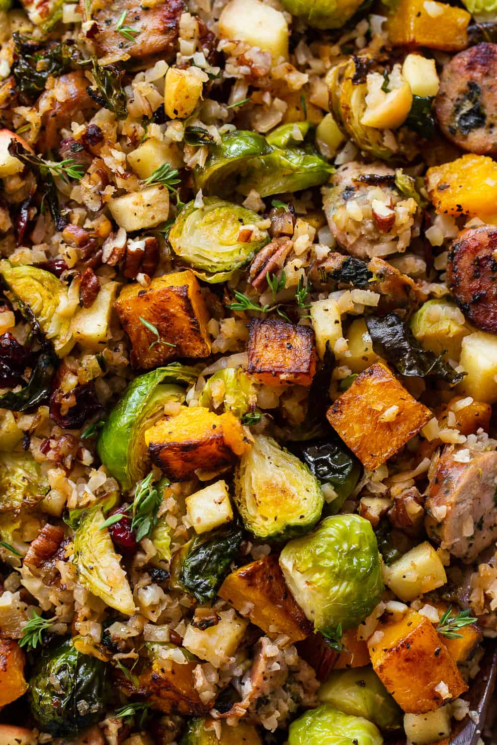 This savory and sweet harvest casserole is packed with veggies, protein, fresh herbs and all the best fall flavors! Serve it as a holiday side dish or a special seasonal meal. The leftovers are delicious for any meal! Paleo friendly, dairy free, Whole30. #paleo #whole30 #cleaneating